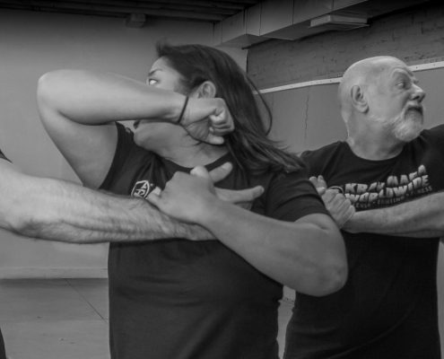 Krav Maga Self Defense - San Francisco Training Center Barny and Jenn elbow strikes Rory Miller at Krav Maga
